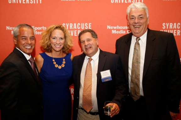 Beth Mowins with her husband, Alan Arrollado, and Alan's co-workers