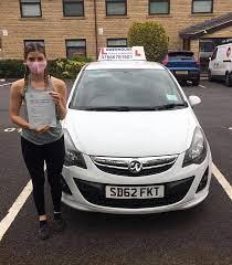 Jade McCarthy standing outside her car