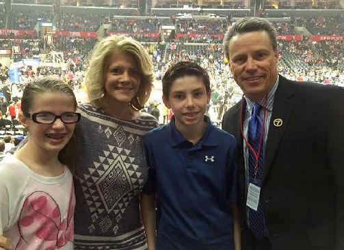 Jeanne Zelasko with her husband, Curt Sandoval, and their children