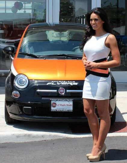 Kacie McDonnell posing with her car