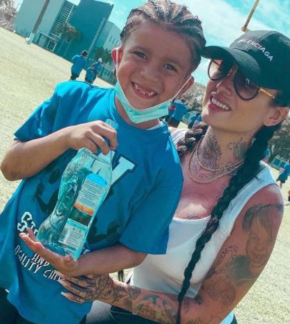 Katherine Flores with her son