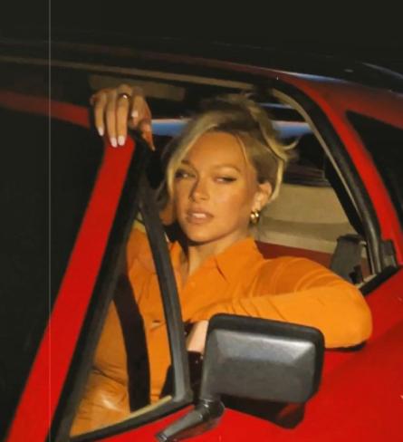 Camille Kosteksitting inside her car